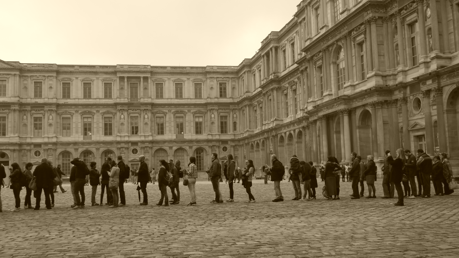 The long que to get the ticket to Louvre.